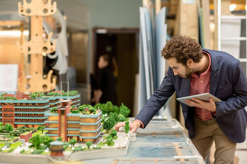 Architect looking at model in front of him